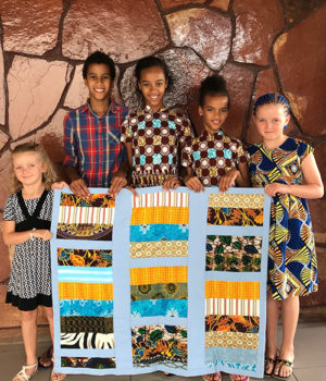 At retreat, missioner kids make a quilt and learn about service